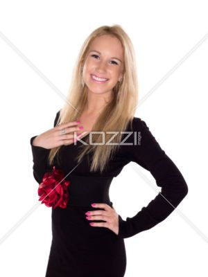 portrait image of a attractive young female posing with hand on hips. - Close-up portrait shot of a beautiful young woman posing with hand on hip against white background. Model: Stephanie Matys