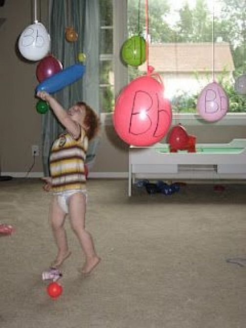 The Preschool Experiment gross motor ideas literacy and more have to think of some way I could do this without ballons I like the idea of having to stretch up to bat at s...