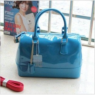 http://pt.aliexpress.com/item/Free-Shipping-2013-New-Arrival-Italy-Star-User-Style-Jelly-Candy-Color-Pillow-Women-Handbags-One/845812155.html