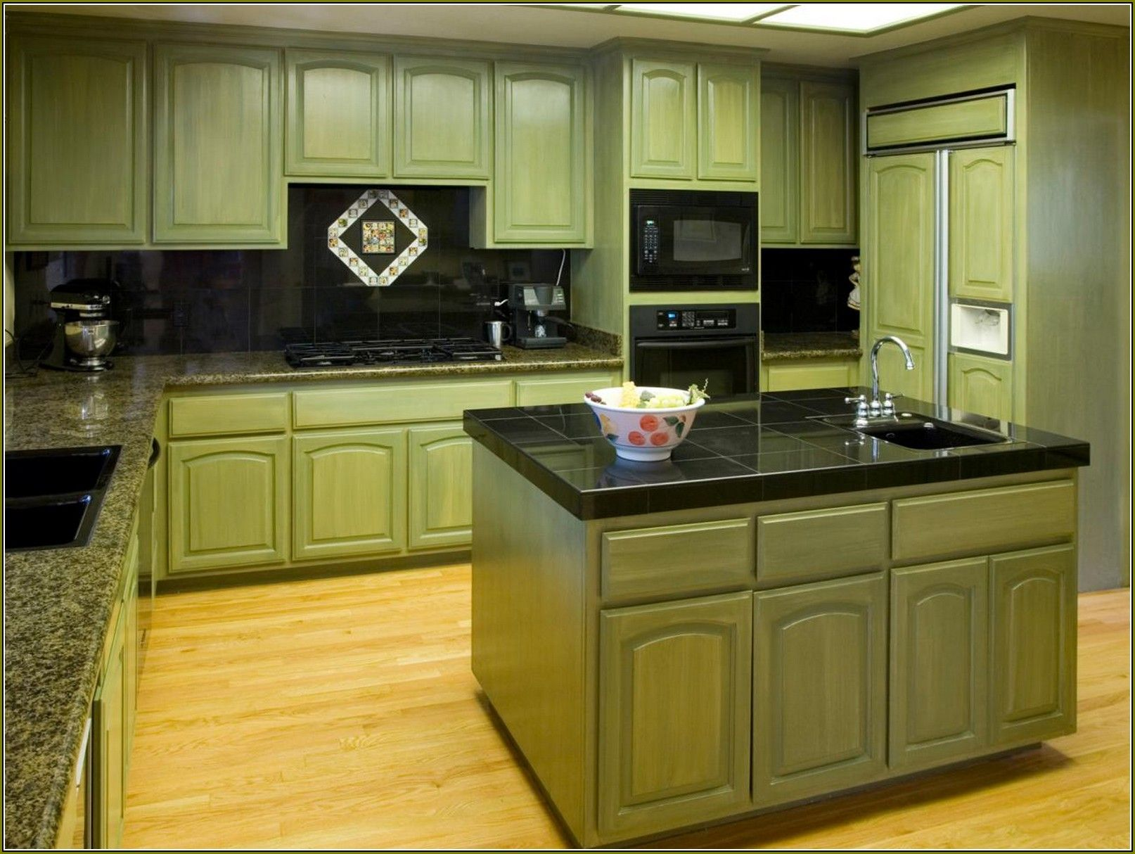 image result for sage green kitchen cabinets with black appliances