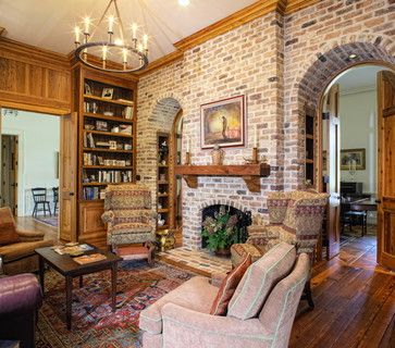 fireplace in middle of entry with archways on either side great room