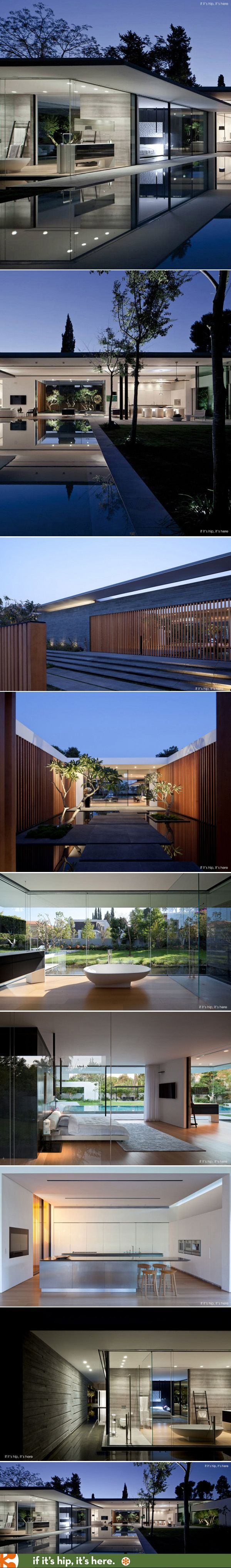 Minimal and modern, the house's characteristic style is defined by the planar surfaces. #architecture #modern