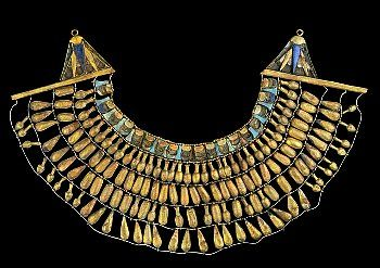 Gold necklace found in an Amarna Period tomb  This broad collar was found around the neck of the mummy in the Amarna period tomb KV 55. The necklace is composed of gold pendants, in the form of lotus and poppy, and inlaid plaques. The endings are large golden lotus flowers inlaid with blue paste. The Lotus, a symbol of rebirth, was a very popular decorative motif in all ancient Egyptian periods.