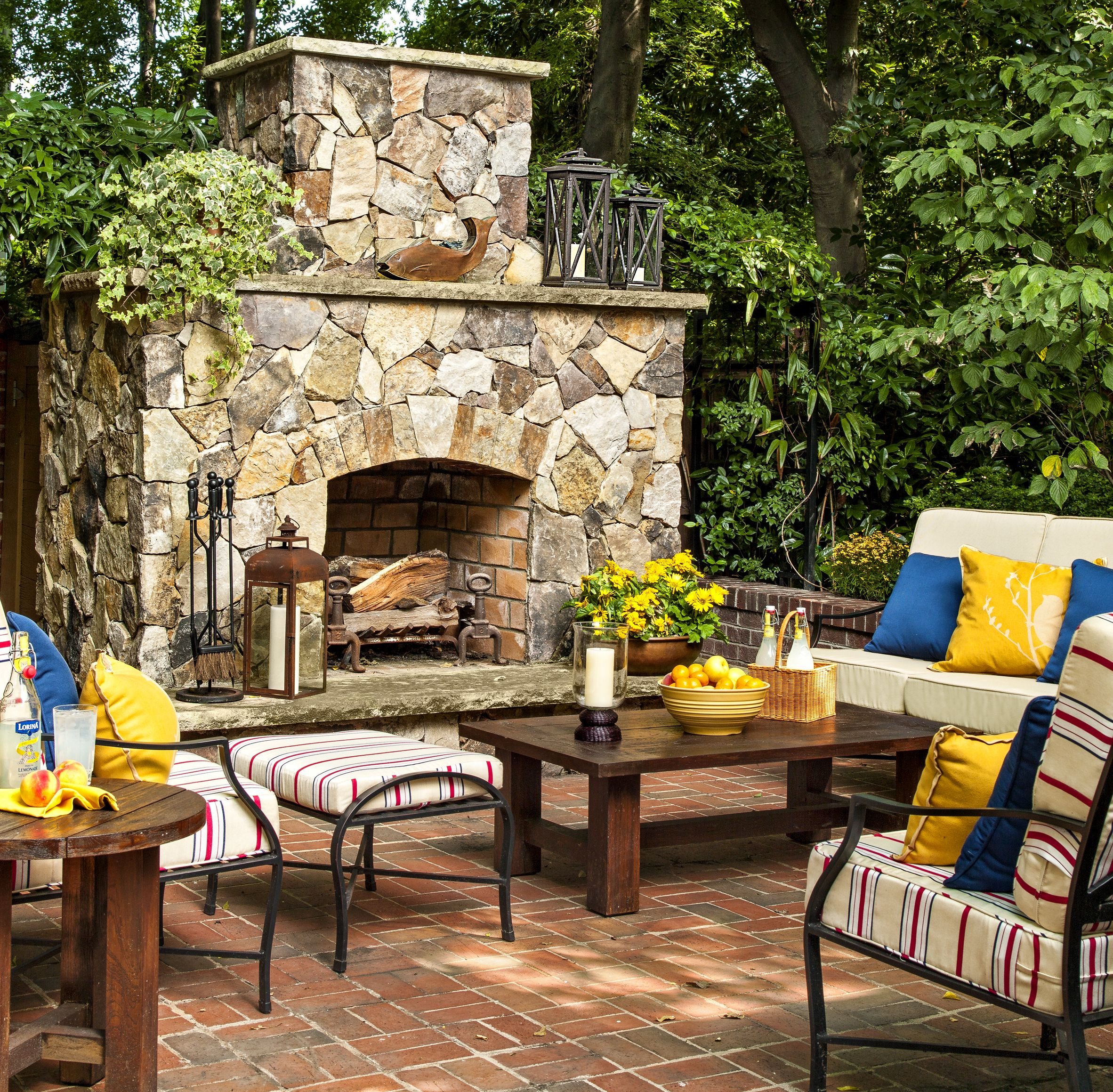 a 1900 house with a comeback story stone fireplaces patios and