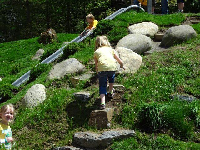 Climbing side of mound to slide