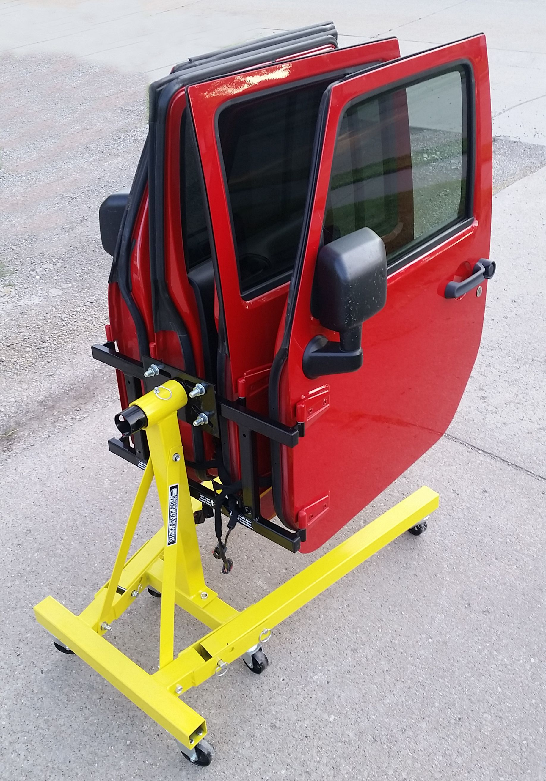 The Stack Rack Roll Door Storage System From Topsy Products It Turns An Engine Stand Into A Mobile Doo Jeep Doors Jeep Wrangler Doors Jeep Hardtop Storage