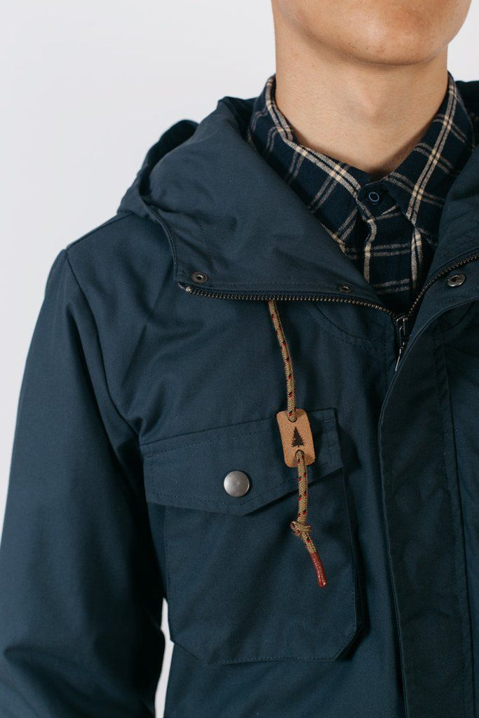 1298c28ffbc Hooded waxed canvas jacket with gusseted dual-entry hand pockets and  flannel lining. This 3-season jacket adds versatility to the new Bridge    Burn