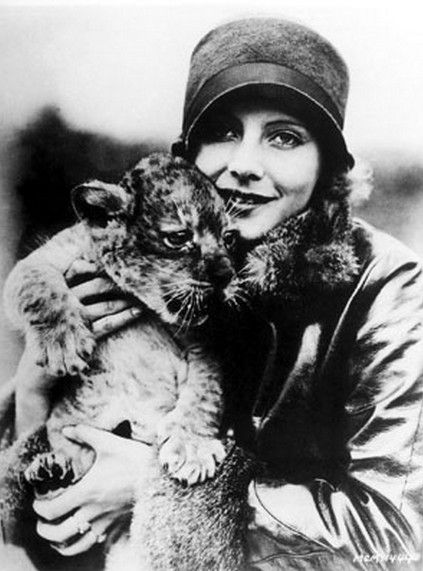 Greta Garbo with a lion cub, Spring of 1926. Photo by Don Gillum for MGM.