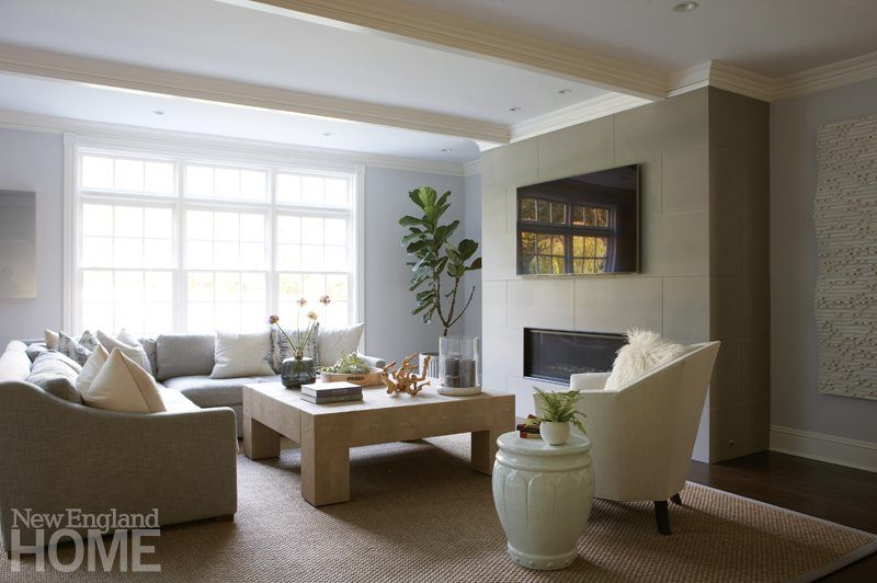 a fireplace fabricated with london fog stone commands attention in