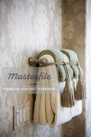 Handle towels on towel bar tied with tassels stock photo - Decorative towel bars for bathrooms ...