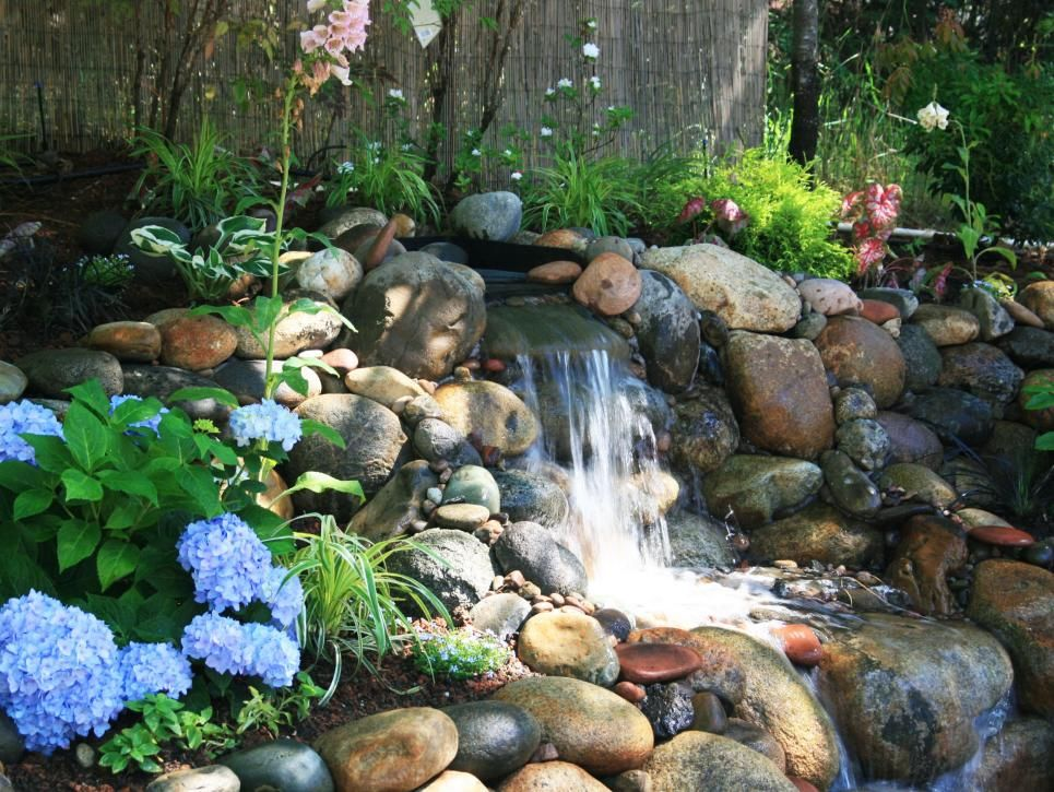 Backyard River Rock Waterfall With Blue Hydrangea Water Features In The Garden Backyard Water Feature Water Features