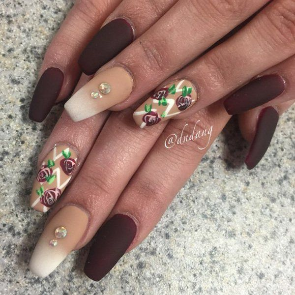 Chocolate brown color isn't really that much used in nails. But here's a combination of the color in matte with lighter brown and white ombre and combinations. You can add roses and diamonds for a more feminine side.