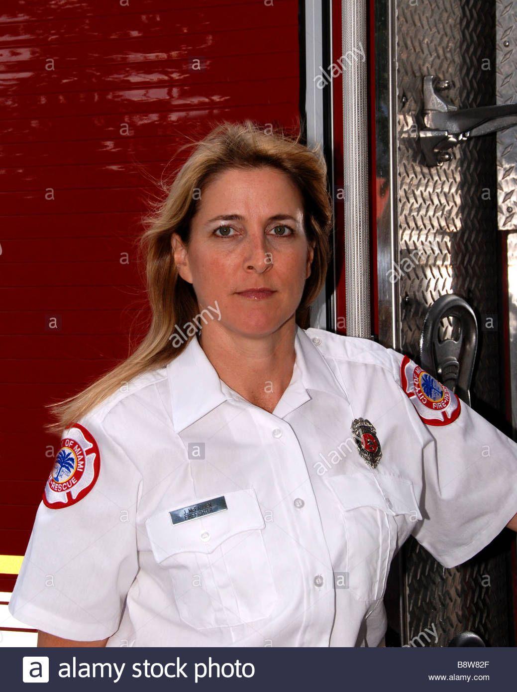 Female firefighter paramedic in dress uniform posing in