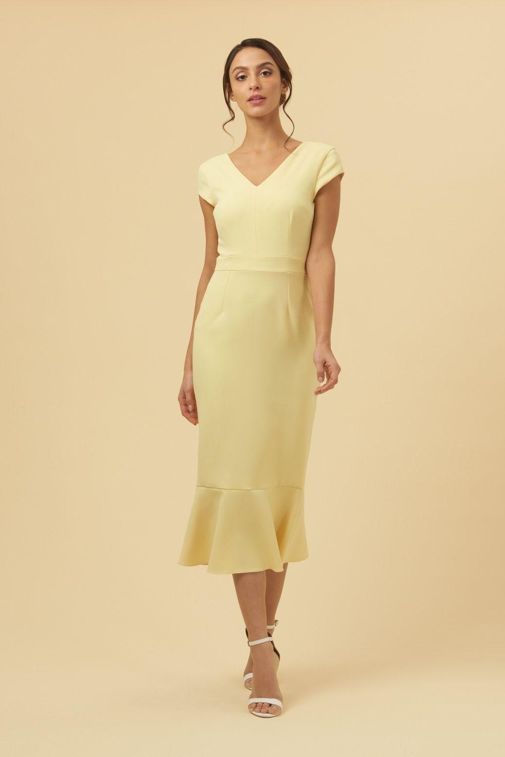c925492814e Introducing the Katja Cap Sleeve Midi Dress. A contemporary design  featuring a V neckline which flows into a flattering square back neckline