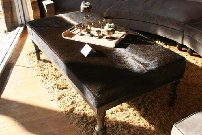 Cowhide Ottoman In Chocolate With Wood Carved Legs