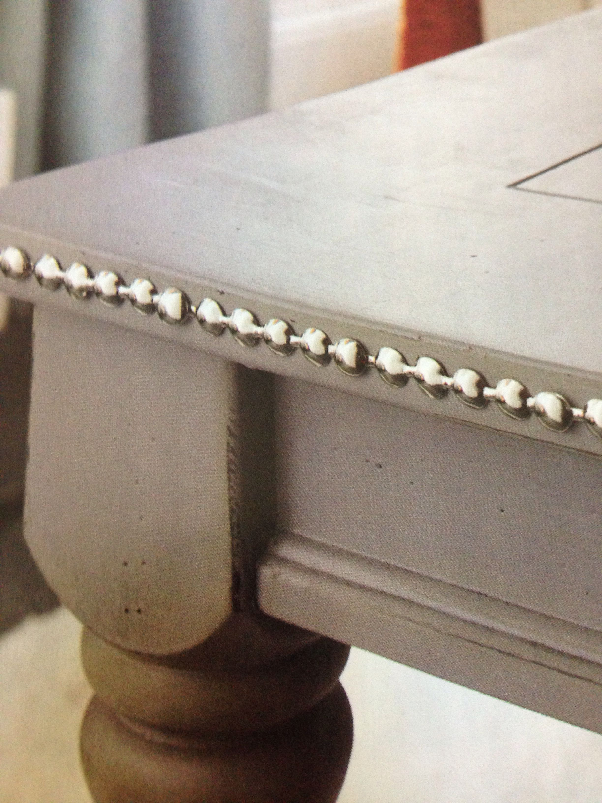 Up cycle an old coffee table with chalk paint and nailhead trim!