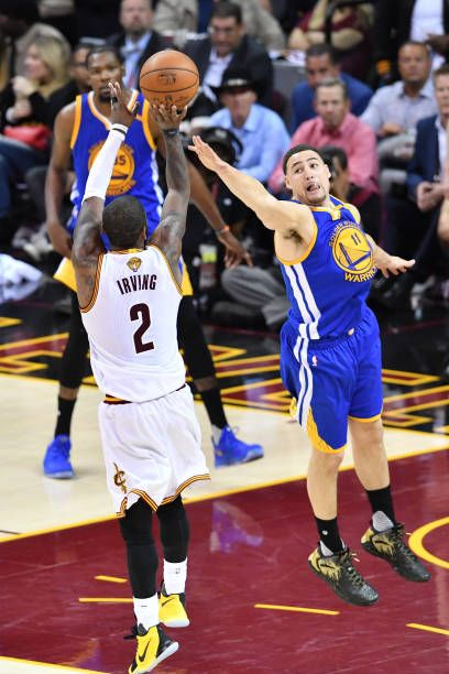Kyrie Irving Of The Cleveland Cavaliers Attempts A Shot Defended By Klay Thompson Of The Gol Klay Thompson Golden State Warriors Pictures Golden State Warriors
