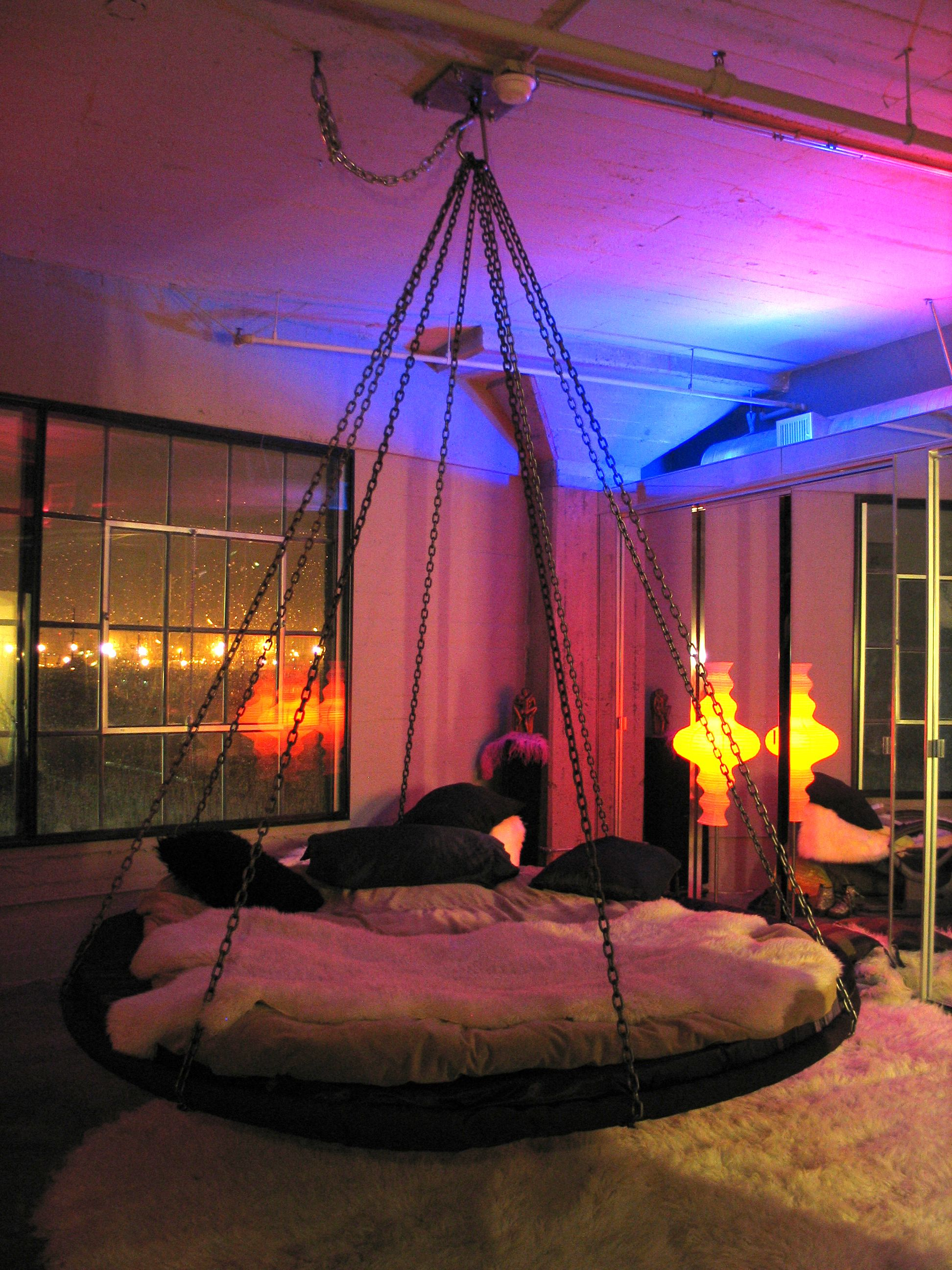 floating round hanging bed with chains and fabulous lighting - Circle Beds Furniture
