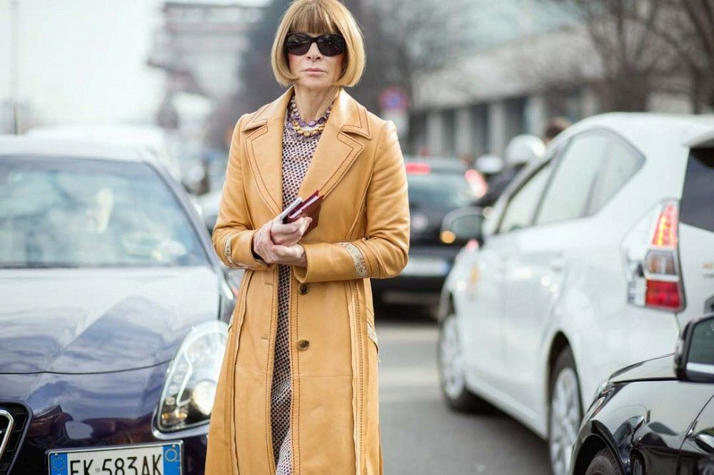 Anna Wintour wearing a leather coat and polka dot printed dress // MFW street style