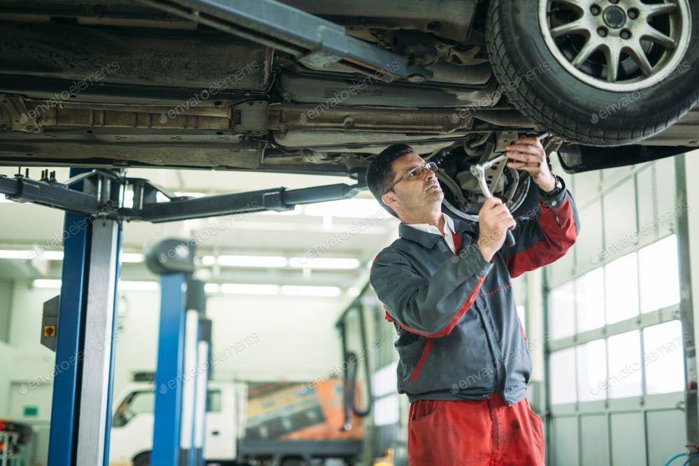 Auto Mechanic Working In Garage Repair Service By Nd3000 S Photos Ad Affiliate Working Mechanic Auto Service Car Mechanic Repair Mechanic