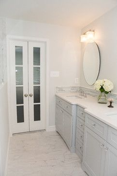 Creating a Tranquil Master Bathroom. New double door with frosted glass. Gray blue painted vanity cabinets.
