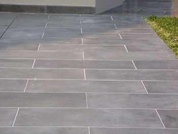 Rectangular Bluestone Set In Concrete One Size A Running Bond Pattern More Modern Than Random