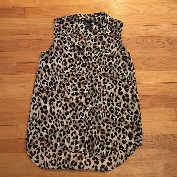 H&M leopard print blouse Sleeve-less H&M button up blouse. Leopard print fun pattern. Size 4. H&M Tops Blouses