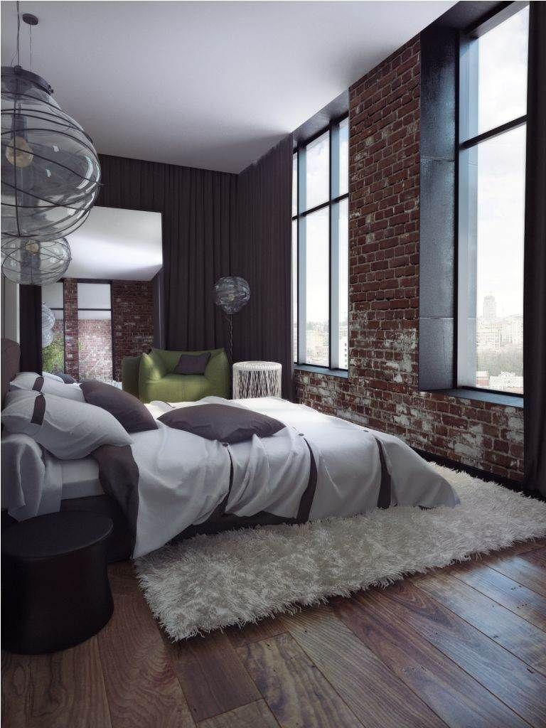 bedroom: modern bedroom decor equipped with brick wall and white