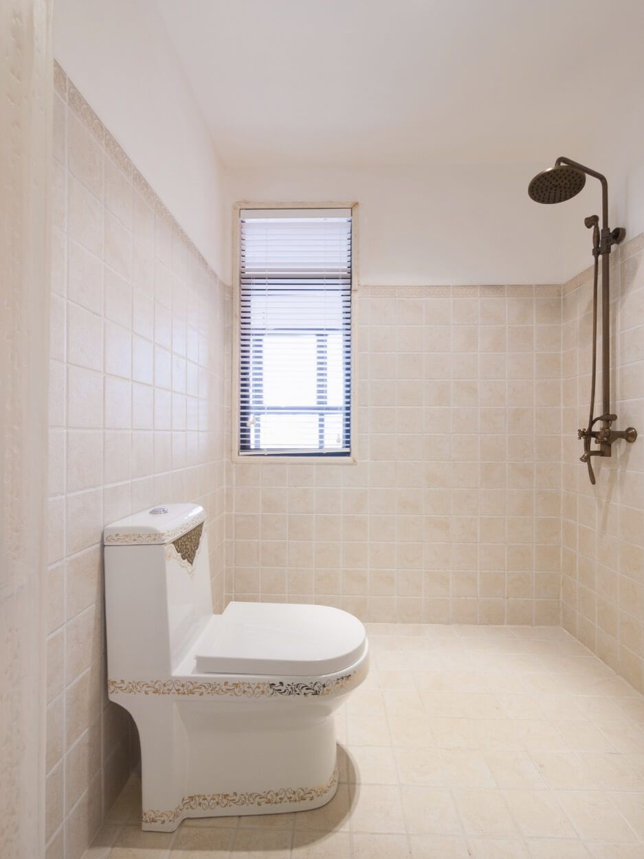 White Toilet With Speckled Design And Open Shower | Renovate Your ...