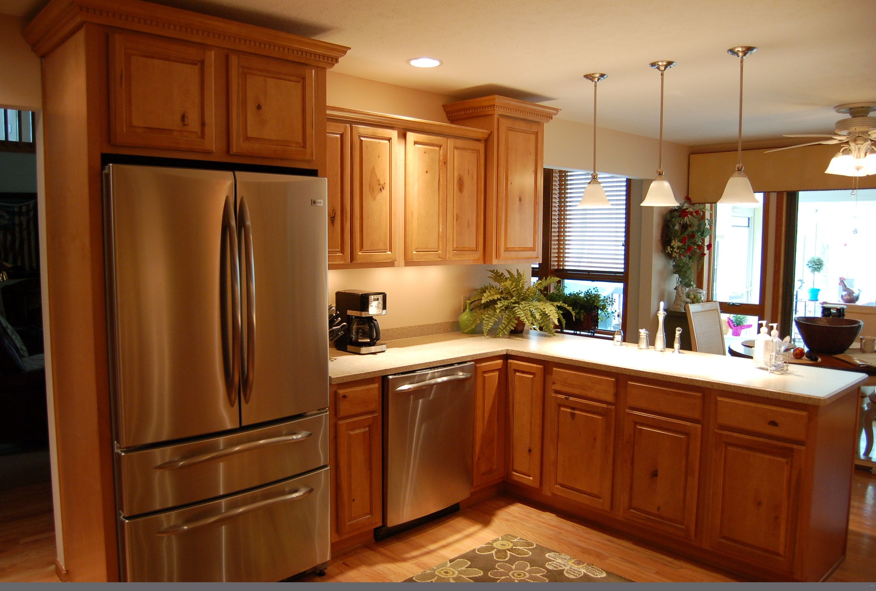 oak kitchen cabinets with white countertop | Ceiling Kitchen Light ...