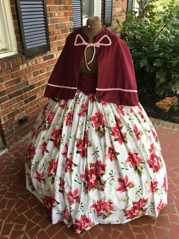 Christmas Civil War/Dicken Christmas Caroling Set.  http://www.cumberlandriversutlery.com/beautiful-burgundy-poinsettia-ms-clause-cape-set.html