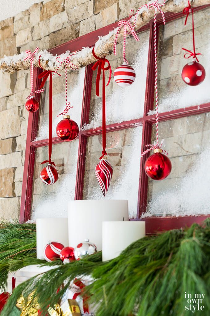 Christmas mantel decorating idea that repurposes an old window sash to create a frosted window pane holiday mantel. #Christmasdecorations #ChristmasDIY, #ChristmasRepurposedDecor #TraditionalChristmasDecorations