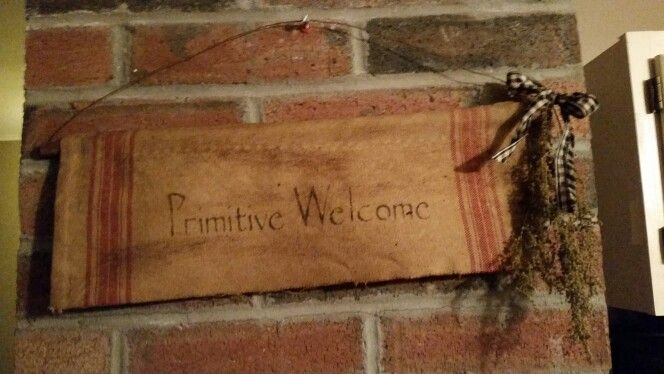 Primitive towel with sprig of sweet annie,  wire hanger