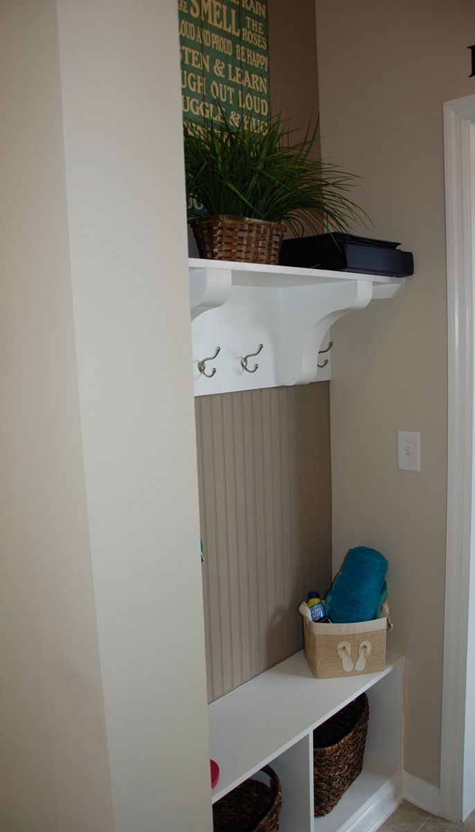 This hallway cubby offers a built in wall organziation for Hallway cubbies