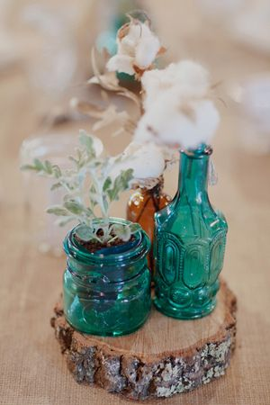 turquoise + cotton centerpieces | Color and Dust  (laura: think blue, and potted plants like favours)
