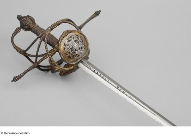 Rapier Unknown Artist / Maker Hilt- possibly North Europe; blade- Italy, possibly Milan c. 1625 - c. 1635 Iron or steel, gold and copper, chiselled and gilded Length: 98.1 cm Width: 2.6 cm Weight: 1.27 kg
