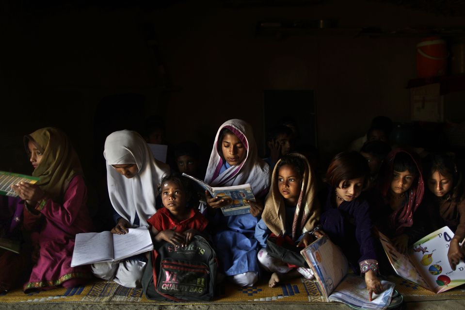 Schoolchildren attended class in a makeshift school in a poor neighborhood on the outskirts of Islamabad, Pakistan, Wednesday. (Muhammed Muheisen/Associated Press)
