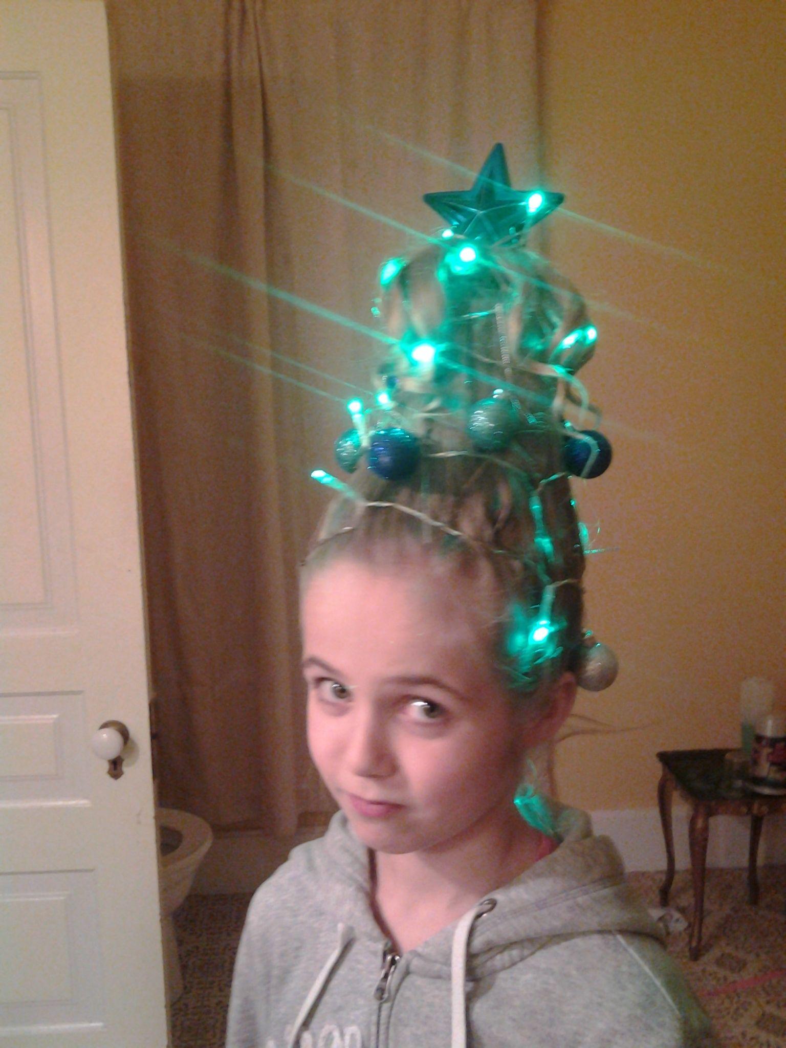 crazy christmas hair style. styrofoam cup inside hair. star stuck in ...