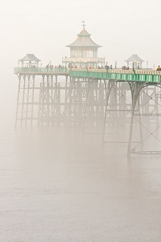 rising in the mist from the Victorian period, the historic Clevedon Pier, Severn Estuary, Somerset, England