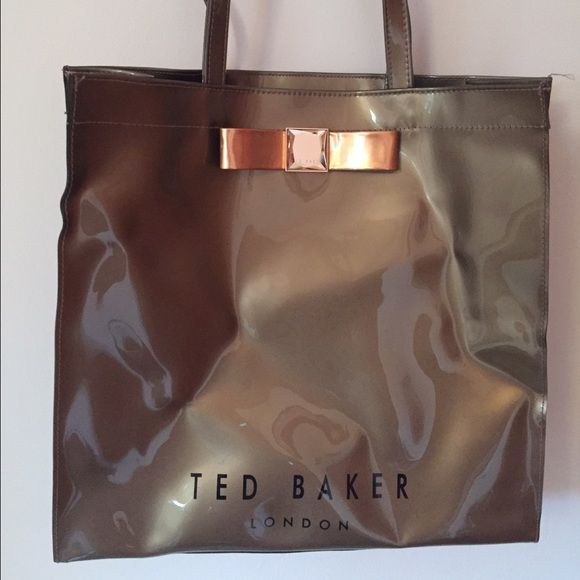 AUTHENTIC Ted Baker Large Shopper Bag A pretty tote that fits a lot! Very used with markings on the front and back of bag. Wear on the corner.  1 compartment with 1 zipper pocket on the back. Ted Baker Bags Totes