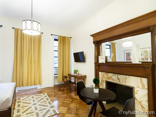 Why Not Toast S Mores Over Your Own Fireplace In This Furnished Apartment In Nyc See It Here Ht New York Apartment Furnished Apartment New York Apartments