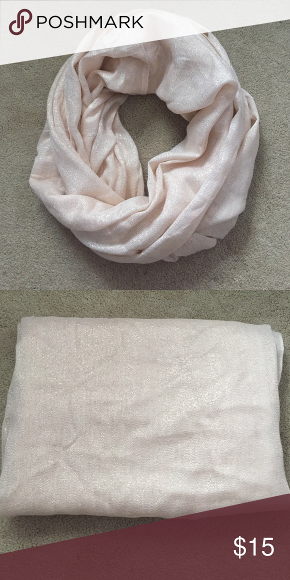 Express Infinity Sparkle Scarf Light pink adorable infinity scarf. Only worn a couple times and still in very good condition. No rips or fraying. Perfect for the holidays! Express Accessories Scarves & Wraps