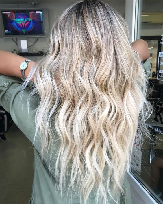 Sexy blonde hair color on wavy hair