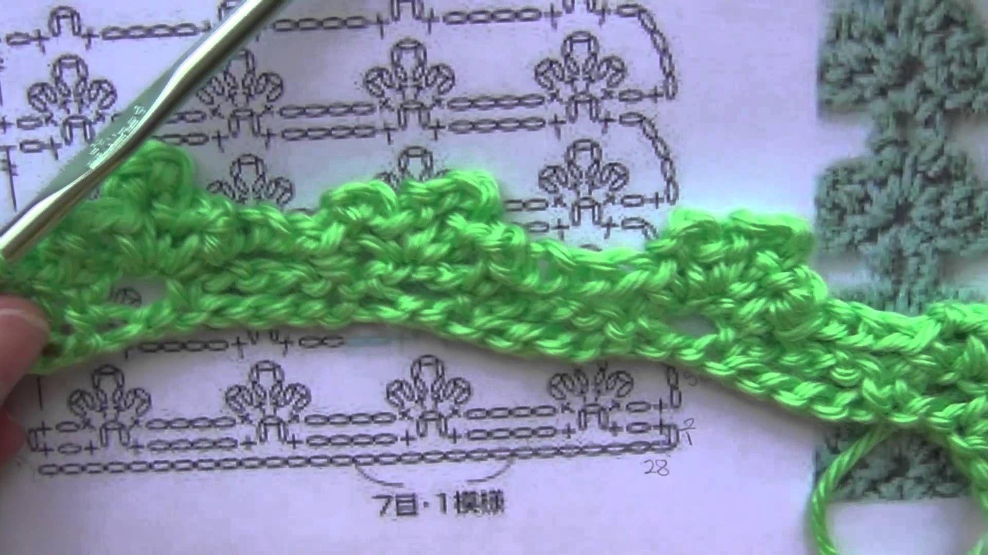 Crochet a lacy stitch using a pattern with symbols