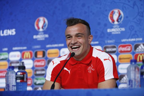 Xherdan Shaqiri of Switzerland laughs as he talks to the media during the Switzerland Press Conference at the Stade Bollaert-Delelis on June 10, 2016 in Lens, France. (Photo by Handout/UEFA via Getty Images)..Picture credit: UEFA (Handout photo provided by UEFA. Only editorial use relating to the event described is permitted. Photo may be distributed to third parties to use for the same purpose provided that no charge is made).