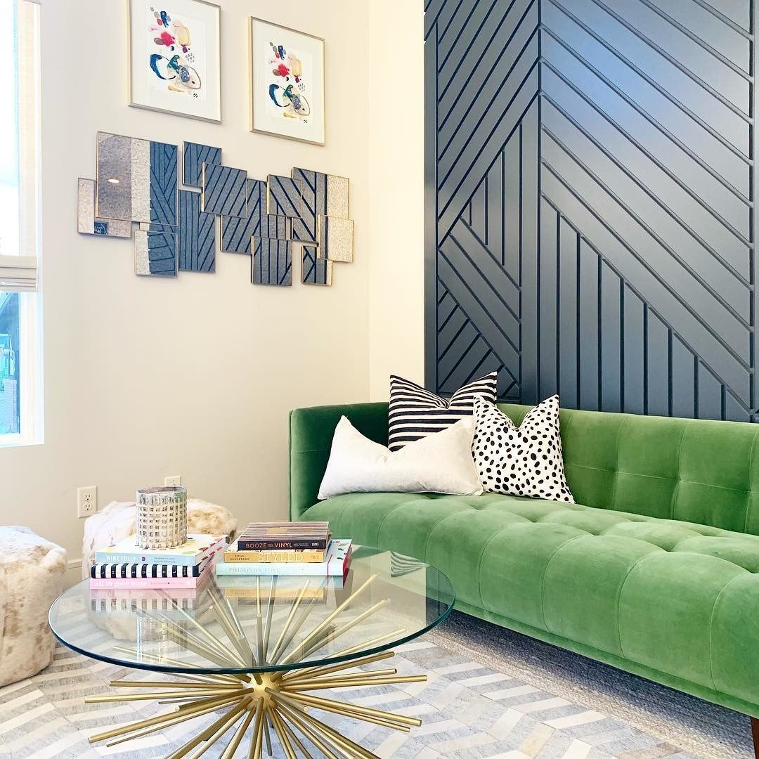 My favorite room in the house, my husband's least favorite. Can you say #funky ?! I don't know what I was thinking when I made selections but this room is #fun #bold #unique and a cool spot to sip a #cocktail and catch up with friends.  #homedesign #utahhomes #formallivingroom #homedecor #interiordesign #greencouch #cowhiderug #pouf #accentwall #livingroom #modern #contemporary #modernlivingroom #westelm #coffeetable