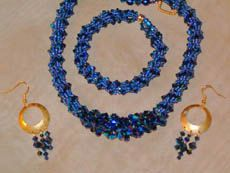 Double Crystal Spiral Necklace, Bracelet and earrings by Linda Gettings