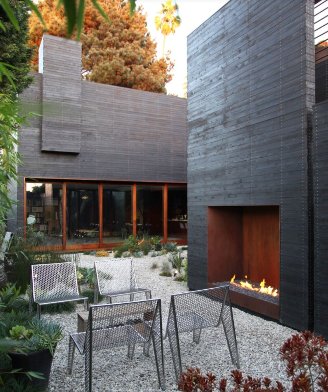 Outside fireplace | Modern outdoor fireplace, Outdoor ...