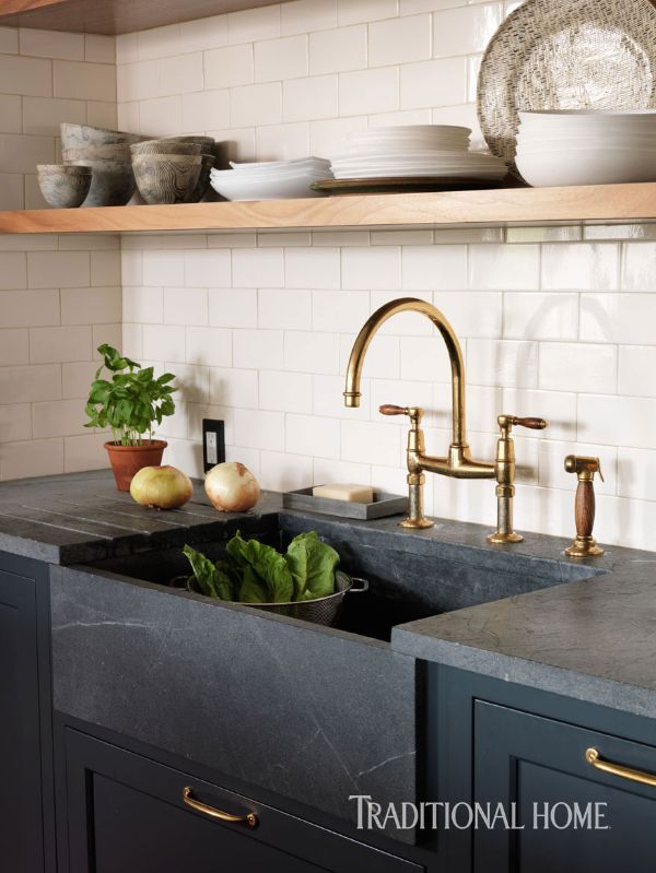 An unlacquered brass faucet from Waterworks and a