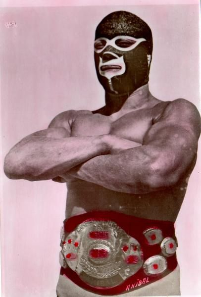 """PAST/PRESENT - Lucha libre (Spanish: """"free wrestling"""") is a term used in Mexico, and other Spanish-speaking countries, for a form of professional wrestling with a unique history in latin culture. Mexican wrestling is characterized by colorful masks, rapid sequences of holds, as well as """"high-flying"""" maneuvers, some of which have been adopted in US professional wrestling. (Herr, J, 2012)"""